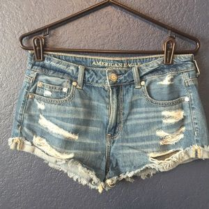 "AEO ""TOMGIRL SHORTIE"" DISTRESSED DENIM SHORTS"